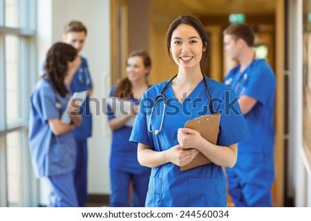 Medical student smiling at the camera at the university