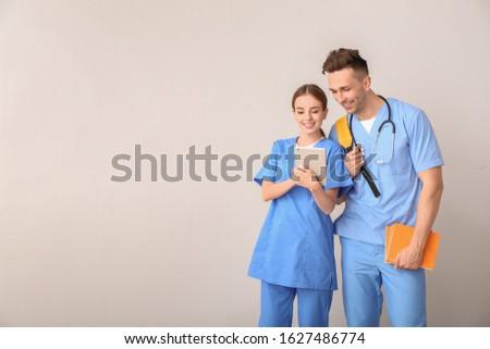 Medical students on light background