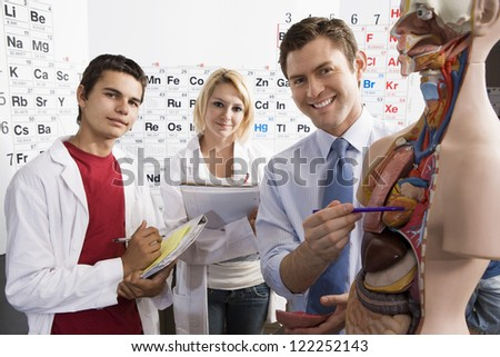 Medical students with professor in classroom