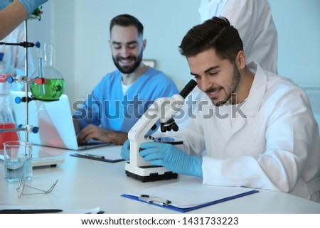 Medical students working in modern scientific laboratory