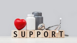 Medical support text with stethoscope red heart and pills or tablets jars. Health care and social workers and doctors, heart check up. Medicine banner with copy space help line