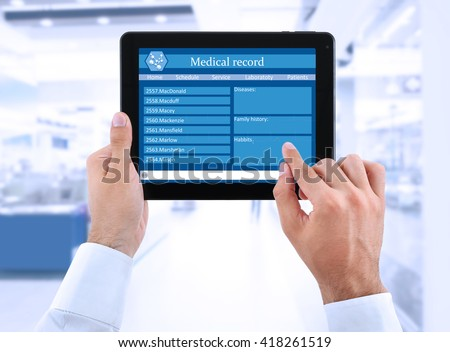 Medical tablet in doctor hands on light background #418261519