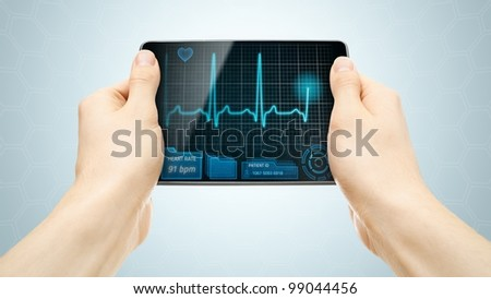 Medical tablet PC showing cardiogram on display.