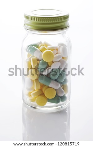 Medical tablets and capsules in small bottle