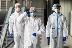 Medical team behind In hazmat suites in hospital