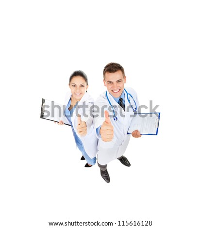 medical team doctor man and woman happy smile point finger at you thumb up gesture. Full length portrait top angle view isolated over white background
