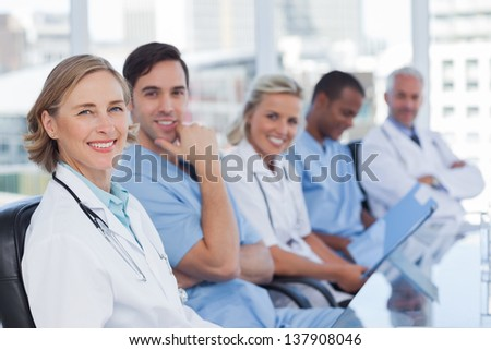 Medical team in row looking at the camera