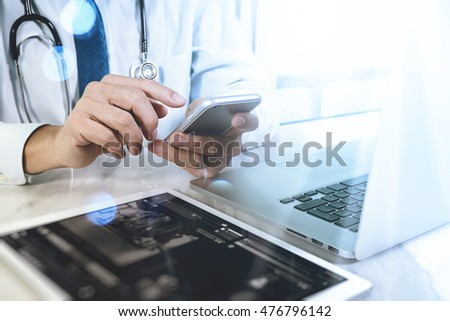 Medical technology concept. Doctor hand working with modern digital tablet and laptop computer with chart interface, Sun flare effect photo