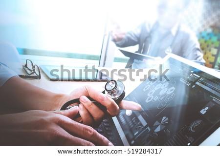 Medical technology network team meeting concept. Doctor hand working smart phone keyboard docking digital tablet screen laptop computer.sun flare effect