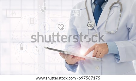 medical technology or medical network. doctor using digital tablet with screen interface.