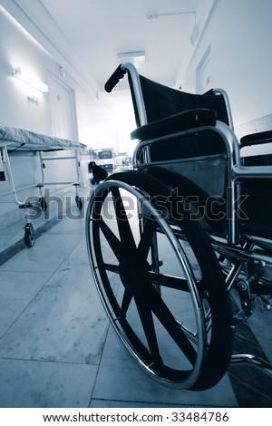 Medical theme: a wheel chair in a hospital.