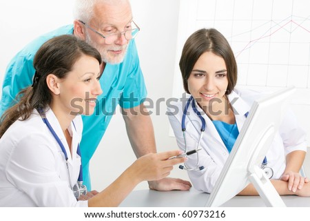 Medical theme: doctors are studying a medical report - stock photo