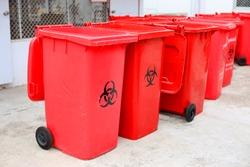 Medical waste bin. Contaminated waste sign. Biohazard trash garbage bin.