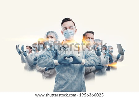 medical workers heroes. a nurse in the foreground in a mask and uniform holds her hands in the shape of a heart. go to a lot of medical professionals.