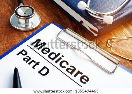 Medicare Part D documents with clipboard on a desk. Photo stock ©