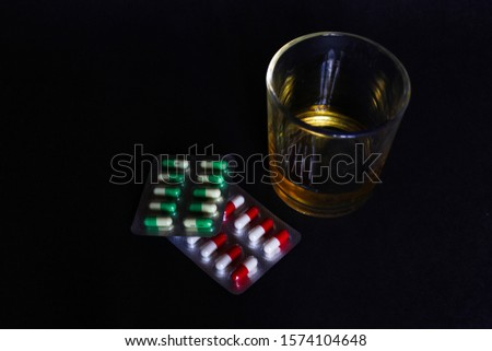 medication and alcohol. The mixing of Alcohol and medication such as pain killers and antidepressants often have bad side effects.