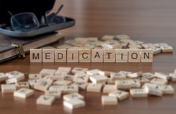 medication concept represented by wooden letter tiles