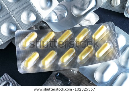 medications in their containers expressing the need to make responsible use of medicines