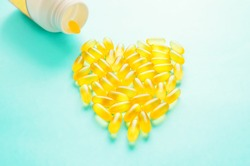 Medicinal capsules are laid out in the shape of a heart. vitamins and medications, vitamin capsules. Close-up, selective focus, background of dosage forms.