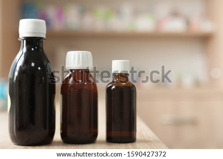 medicinal medicine from herbs in a pharmacy on the background of medicines