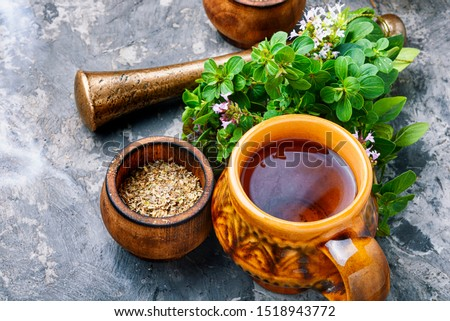 Medicinal tea from marjoram leaves.Herbal tea with oregano. Stock photo ©