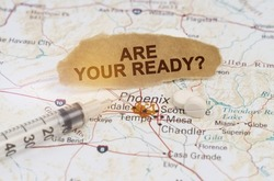 Medicine and health concept. On the map of Arizona lies a syringe, pills and paper with the inscription - ARE YOUR READY