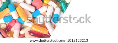 Medicine blue and yellow pills or capsules on white background with copy space. Drug prescription for treatment medication. Pharmaceutical medicament, cure in container for health. Antibiotic #1012123213