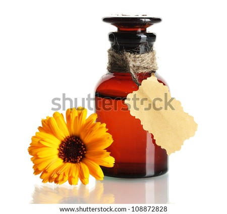 medicine bottle and beautiful calendula flower, isolated on white