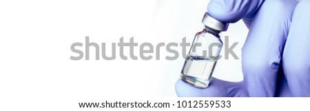 Medicine bottle for injection in hand, palm of a doctor. Medical glass vial for vaccination. Science equipment, liquid drug or vaccine from treatment, flu in laboratory, hospital or pharmacy.