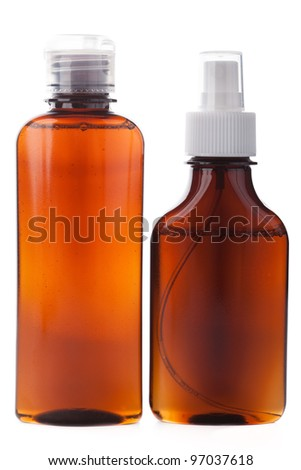 Medicine bottle of brown glass isolated on white background with liquid and white plastic cap. Frontal view, blank for label