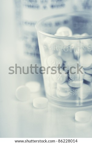 Medicine bottles and pills close up with copyspace
