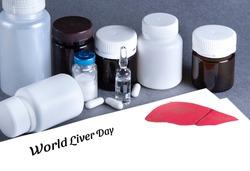 Medicine bottles, vaccine, white paper with lettering World Liver Day. Cancer of the liver, Hepatitis, Hepatitis C, virus. Mockup