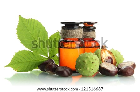 medicine bottles with chestnuts and leaves, isolated on white - stock photo