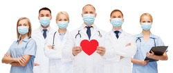 medicine, cardiology and healthcare concept - group of doctors wearing protective medical masks with red heart and stethoscopes over white background
