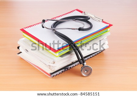 Medicine concept with stethoscope and books