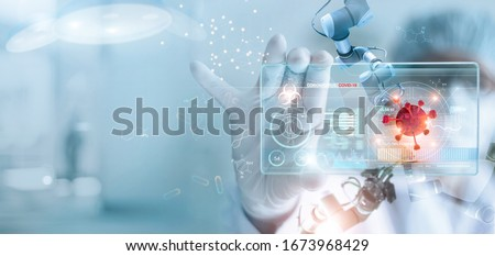 Medicine doctor and robotics research and analysis. Diagnose checking coronavirus or covid-19 testing result with virtual screen in laboratory, Inhibition of disease outbreaks and Medical technology