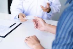 Medicine doctor consultant explaining to patient about problem diagnosis.