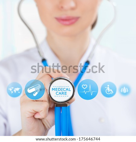 Medicine doctor hand holding stethoscope and working with modern medical icons