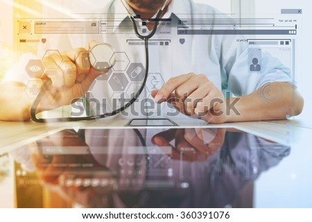 Medicine doctor hand holding stethoscope with modern computer interface as medical network concept