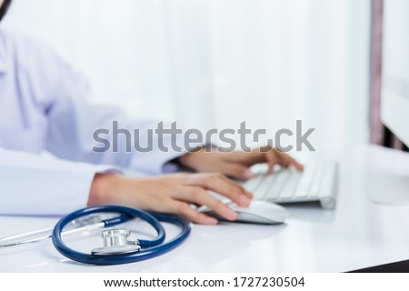 Medicine doctor's working on desk. Closeup of Stethoscope. Hand of woman physician type keyboard to order medicine for patients on table front PC computer at hospital office, Healthcare medic concept