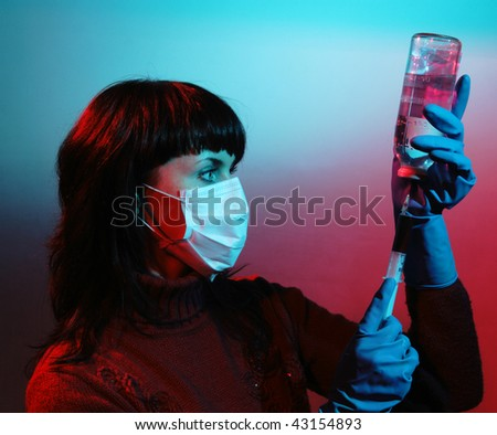 Medicine doctor with medical syringe in hands, A(H1N1), an abstract color environment