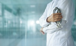 Medicine doctor with stethoscope in hand on hospital background,  Medical technology, Healthcare and Medical concept.