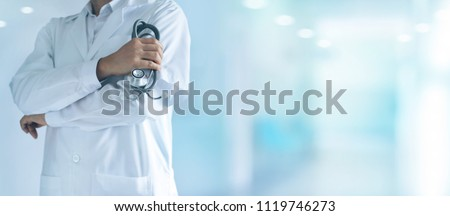 Medicine doctor with stethoscope in hand standing confidently on hospital background, healthcare concept.