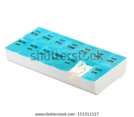Medicine dose box isolated on white background. Weekly dosage of medication in blue pill dispenser