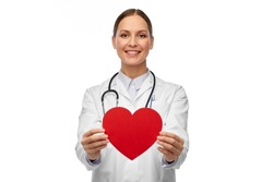 medicine, healthcare and cardiology concept - smiling female doctor with red heart and stethoscope