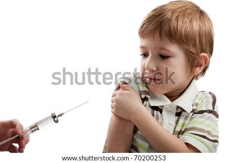Medicine healthcare syringe injecting scared child