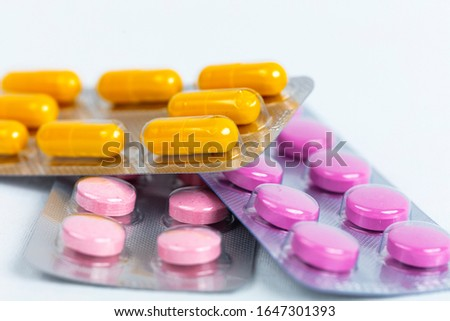 Medicine, medicine, health concept. Various capsules, pills and blisters are the background of a large group.