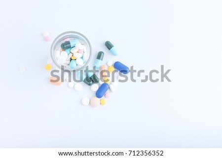 Medicine of glass, Colorful medicine, Medicine and capsules on over white background. With space for text your, Top view