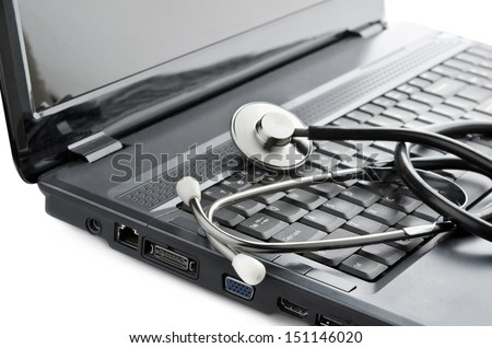 Medicine online. Close up of stethoscope on computer keyboard