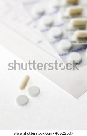 Medicine package on the medicine paper bag and some medicine.